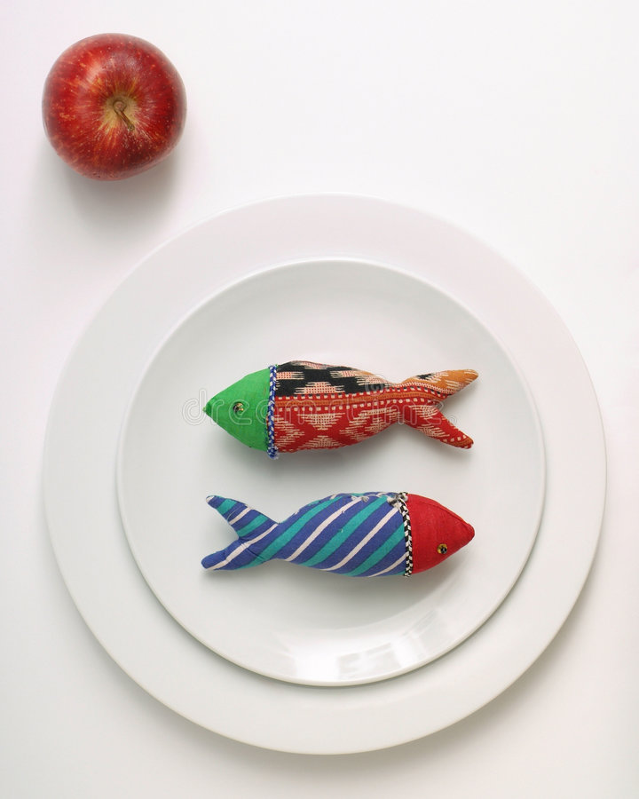 Diet fish and apple stock photos