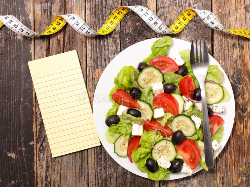 Diet food concept. Mixed vegetable salad and meter royalty free stock photography