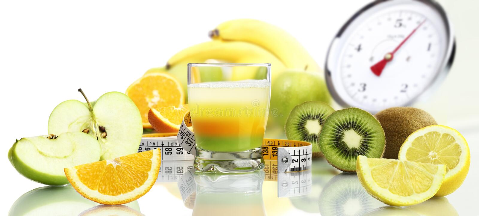 Diet food concept vitamins mixed multi fruit drink. And scales stock photo