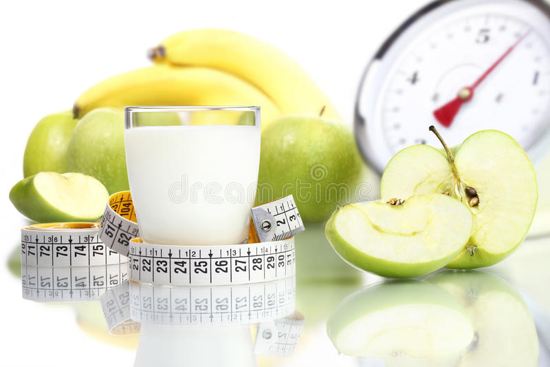 Diet food milk glass, fruit Apple meter scales. Diet concept stock photos