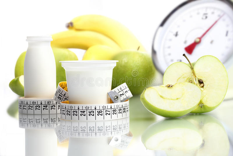 Diet food yogurt fruit Apple meter scales. Diet concept royalty free stock photography