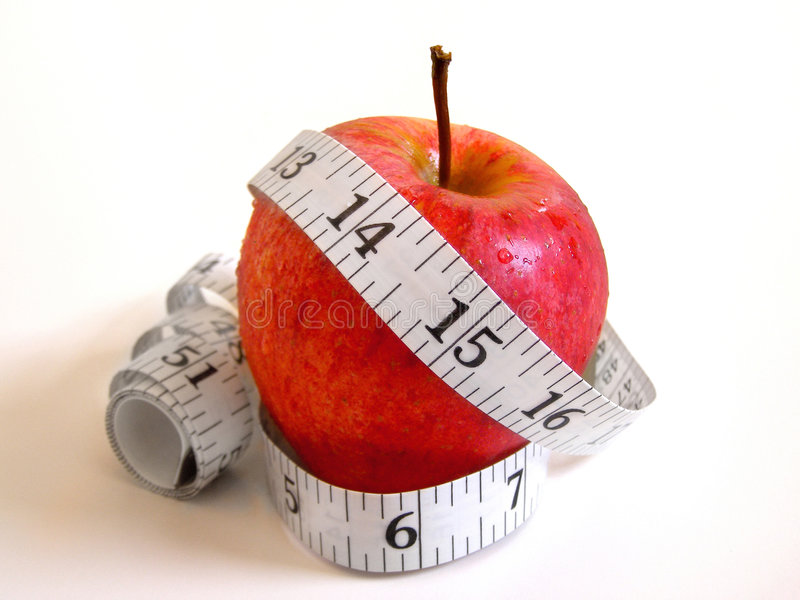 Diet Fruit (Apple) with measure tape royalty free stock images
