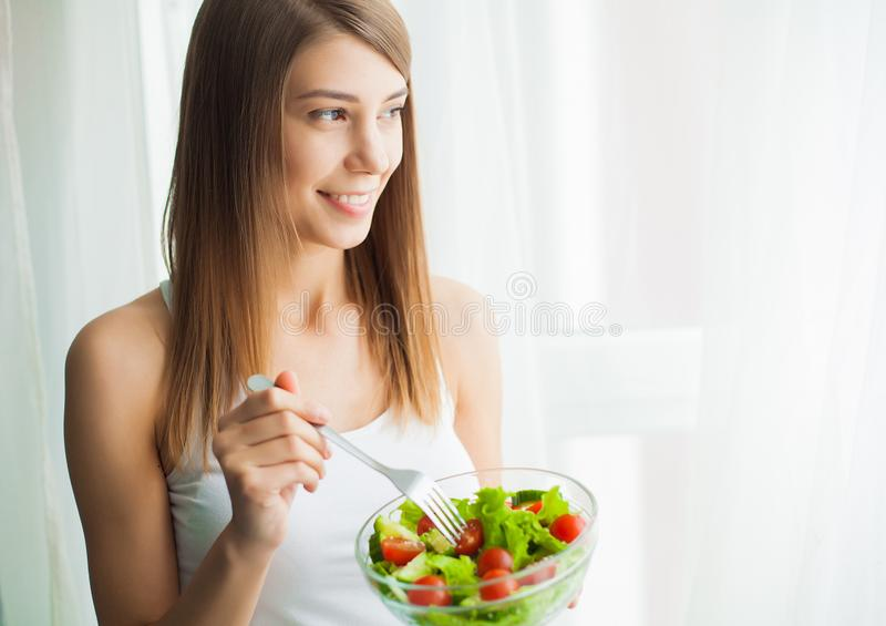 Diet and health.Young woman eating healthy food after workout. Diet and health. Young woman eating healthy salad after workout stock image