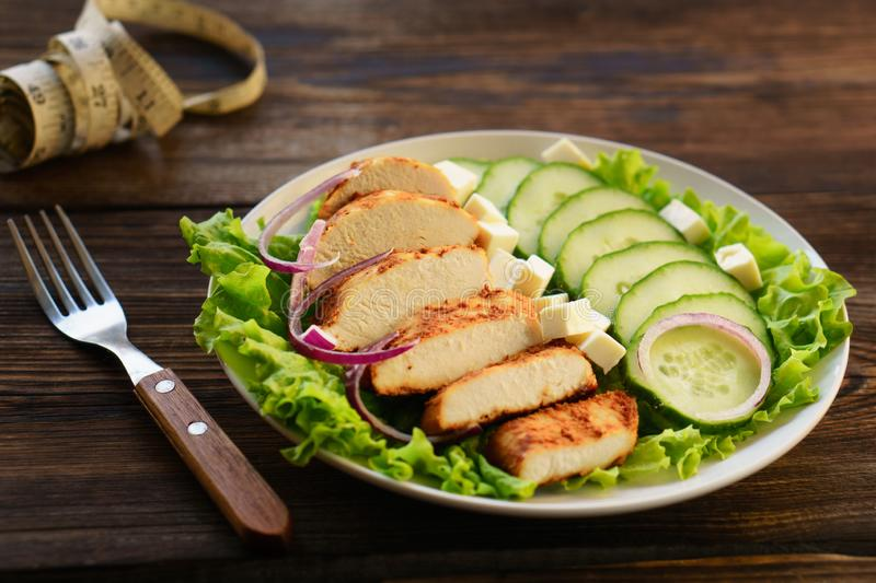 Diet, healthy eating, balanced food, baked chicken. Diet, healthy lifestyle, low calorie food, keto, proteins, low fat. Baked chicken breasts with vegetables and royalty free stock image