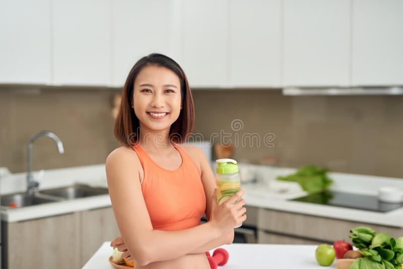 Diet. Healthy Eating Woman Drinking Fresh Raw Green Detox Vegetable Juice royalty free stock photo
