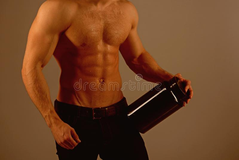 On a diet. Man with six pack abs. Stimulating muscle growth with anabolic steroids. Anabolic hormone increases muscle. Strength. Vitamin nutrition. Healthy diet stock photography