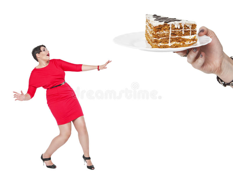 Diet and nutrition concept. Plus size woman afraid cake stock photography