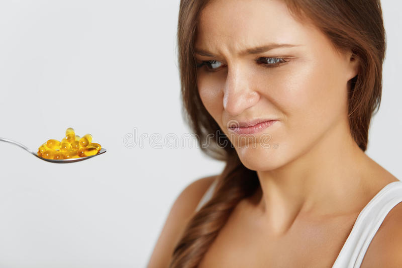 Diet. Nutrition. Vitamins. Healthy Eating. Woman With Fish Oil O royalty free stock images