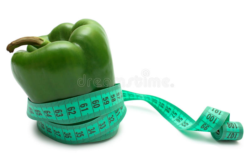 Diet: pepper tighten measuring tape isolated on wh. Vegetable diet. Green bell pepper (bulgarian) tighten measuring tape isolated on white stock photography