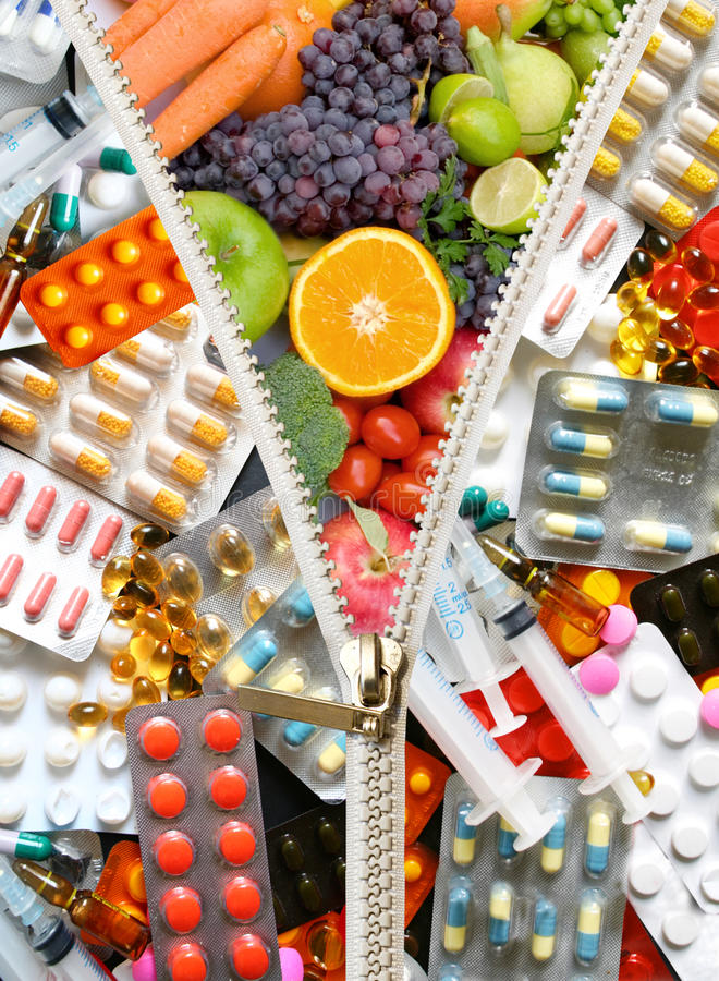 Diet pills. Replaced by fruits and vegetables show healthy diet stock images