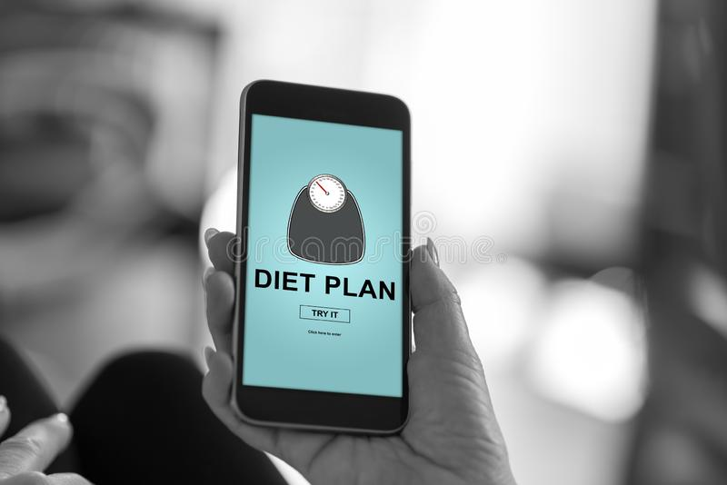 Diet plan concept on a smartphone. Smartphone screen displaying a diet plan concept stock images