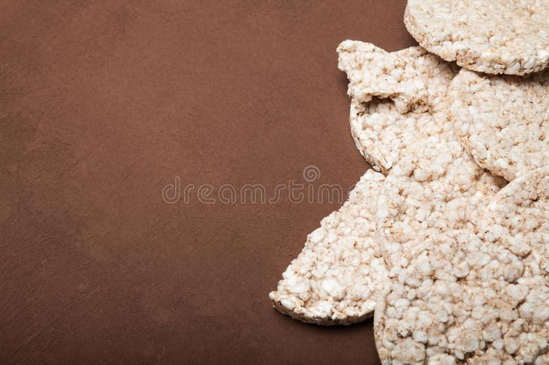 Diet rice cakes on brown background, copy space for text.  stock photography