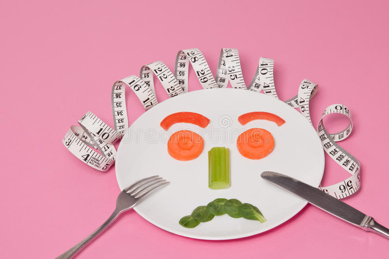 Diet Salad Face. On White Plate Pink Background stock images