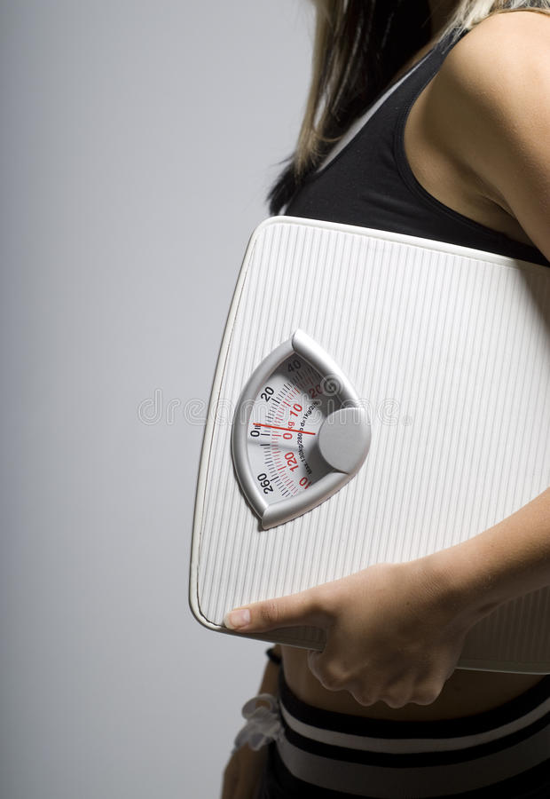 Diet scale and woman portrait shape royalty free stock photos