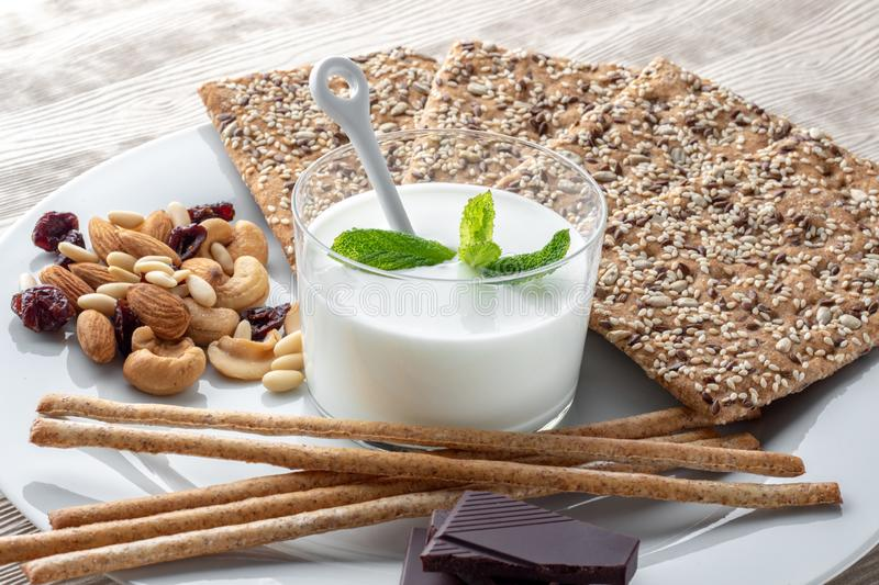 Diet snack with organic kefir and bread crackers. royalty free stock photo