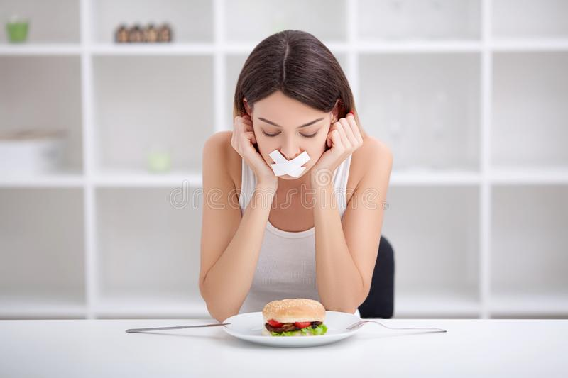 Diet. Unhealthy eating. Junk food concept. Girl don`t eat junk f. Ood royalty free stock photography
