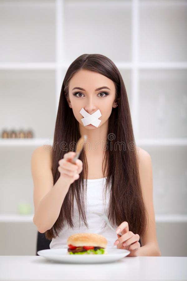 Diet. Unhealthy eating. Junk food concept. Girl don`t eat junk f. Ood royalty free stock images