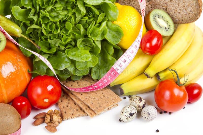 Diet väger förlustfrukostbegrepp royaltyfria foton