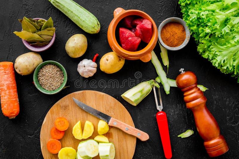 Diet vegetarian vegan food. Ratatouille or vegetable ragout. Black table background top view stock images