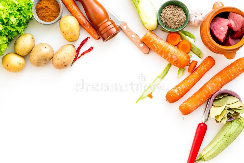 Diet vegetarian vegan food. Ratatouille or vegetable ragout. White table background top view mockup stock image