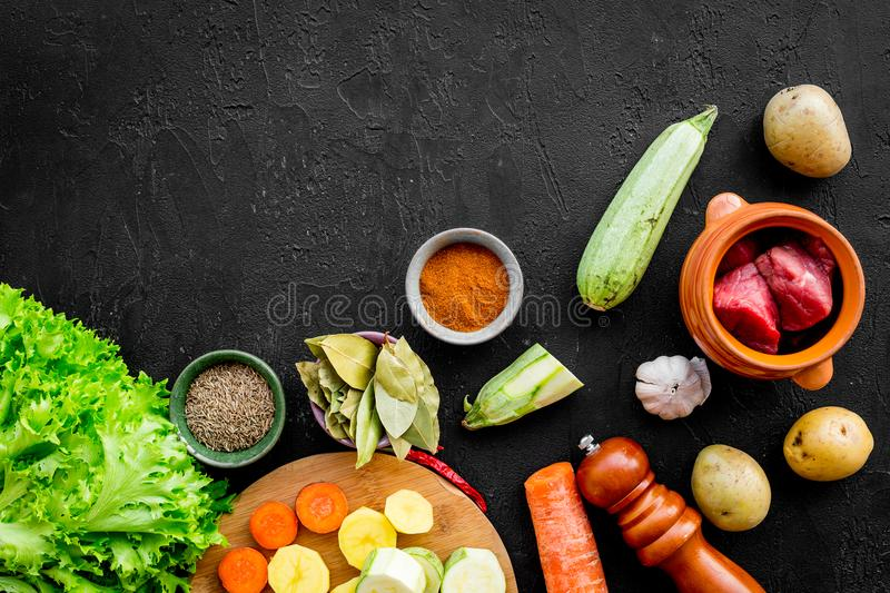 Diet vegetarian vegan food. Ratatouille or vegetable ragout. Black table background top view space for text royalty free stock images