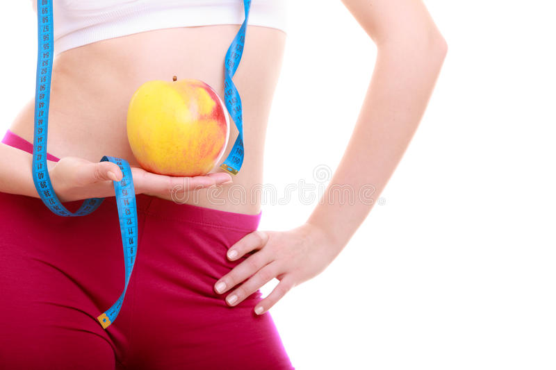 Diet. Waist of fit girl with measure tape apple. Time for diet slimming weight loss. Health care and healthy nutrition. Waist of young fitness woman fit girl royalty free stock image
