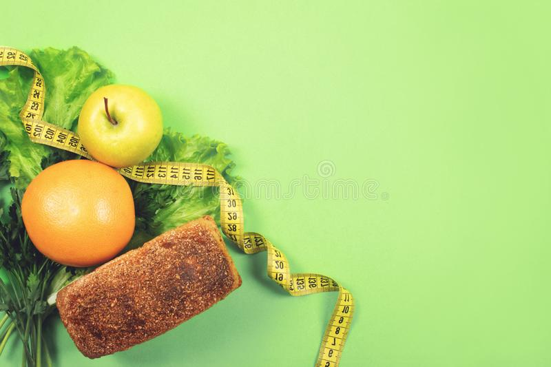 Diet, weigh loss, healthy eating, fresh food concept. Healthy food whole grain bread, vegetables, fruits and greens, herbs with. Diet food healthy dieting eat stock images