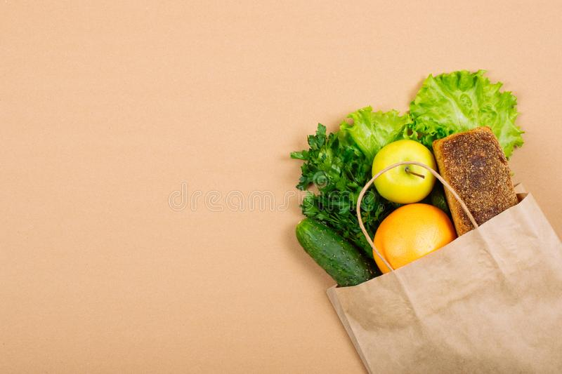 Diet, weigh loss, healthy eating, fresh food concept. Healthy food whole grain bread, vegetables, fruits and greens, herbs with. Paper bag on green background stock image