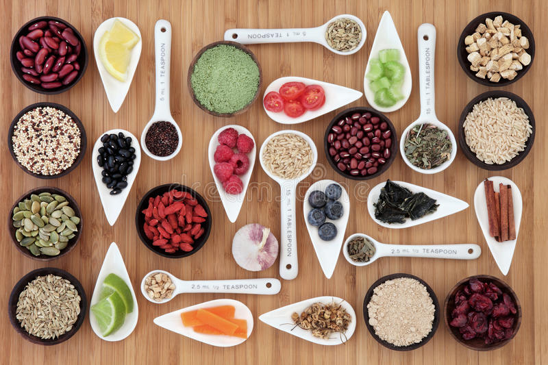 Diet and Weight Loss Food. Large weight loss and diet super food selection in bowls and measuring spoons over bamboo background royalty free stock photography