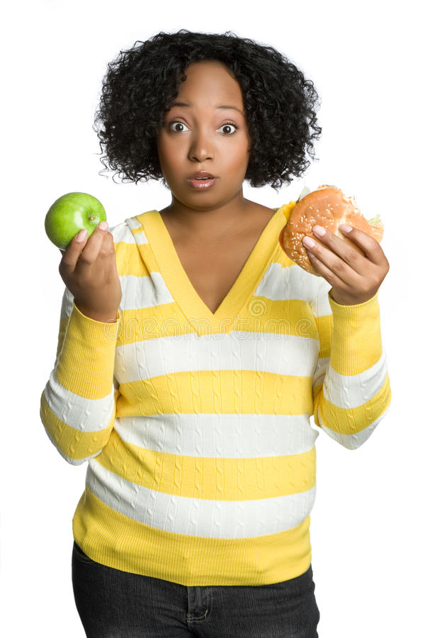 Diet Woman. Confused diet hamburger apple woman stock images