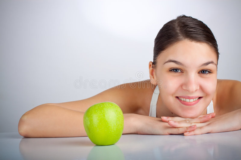 Diet Woman. Happy woman smiling near a green apple stock photo