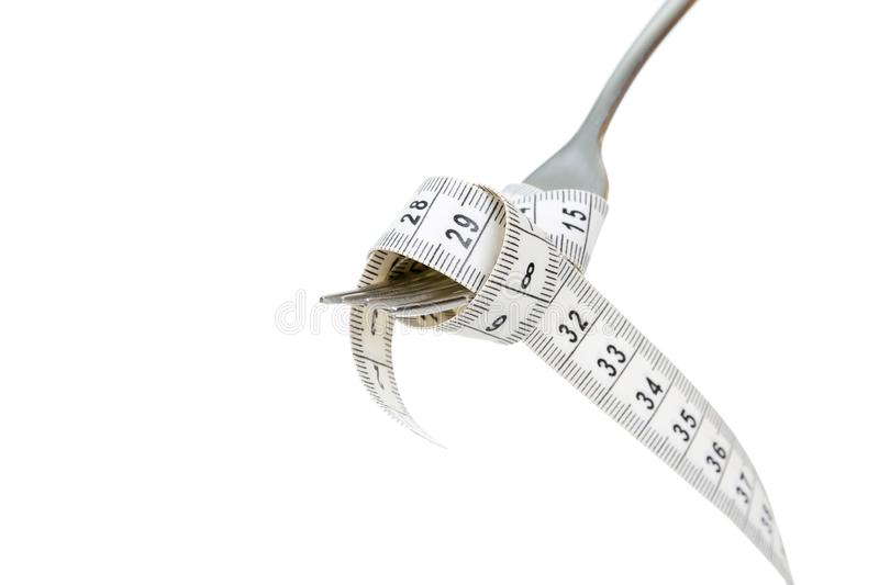 Diet and wweight loss concept, fork and measuring tape royalty free stock images
