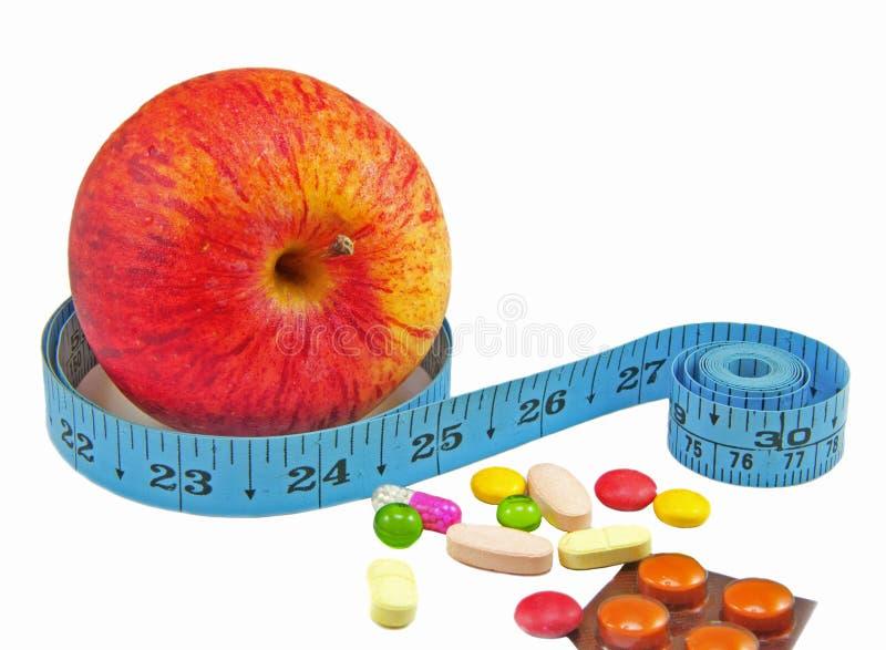 Dieta contra a medicina imagem de stock royalty free
