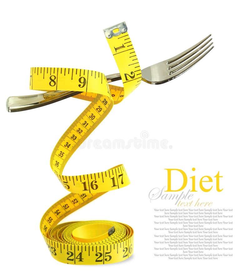 Dieta equilibrada representada por uma forquilha na fita de medição imagem de stock