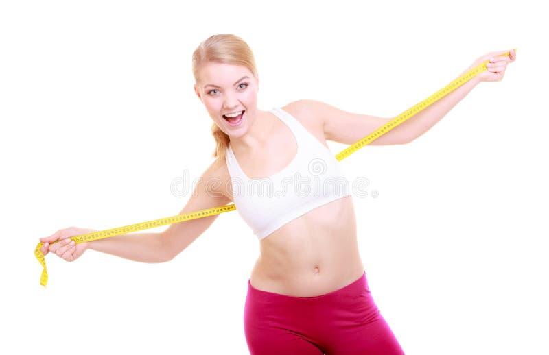 Dieta. Menina apta da mulher da aptidão com medida da fita isolada fotografia de stock royalty free