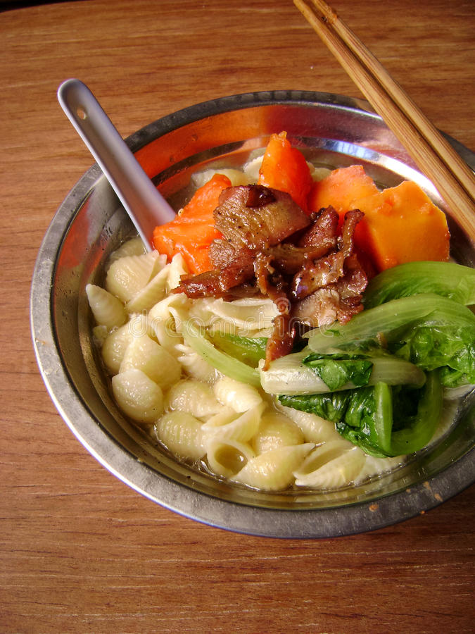 Dietary balance noodle soup. Close up of delicious Asian noodle with cabbage, papaya and beef. Chopstick and spoon are included stock image