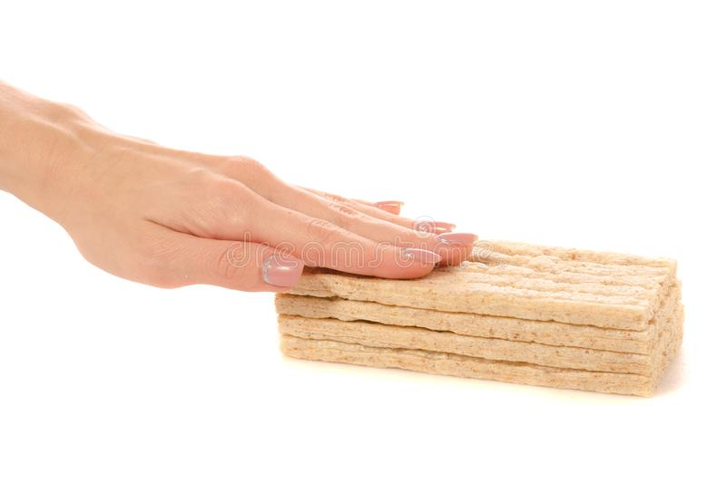 Dietary bread slices in hands. On a white background isolation royalty free stock photography
