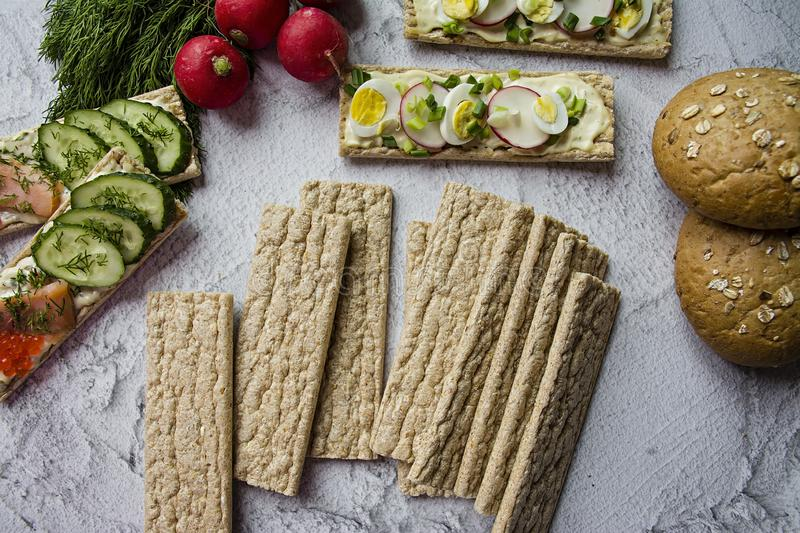 Dietary bread. Substitute for slimming bread. Vegetarian sandwiches. Proper nutrition. Light background. Close-up.  royalty free stock images