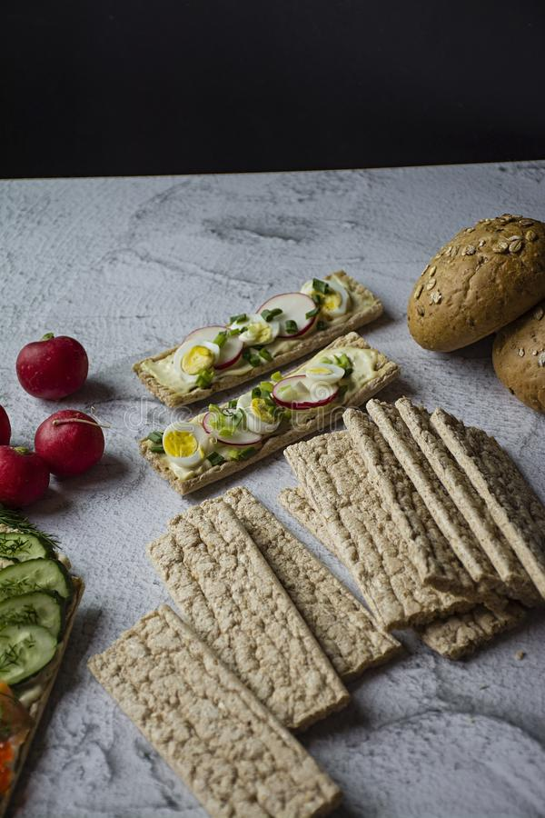 Dietary bread. Substitute for slimming bread. Vegetarian sandwiches. Proper nutrition. Light background. Close-up.  stock photography