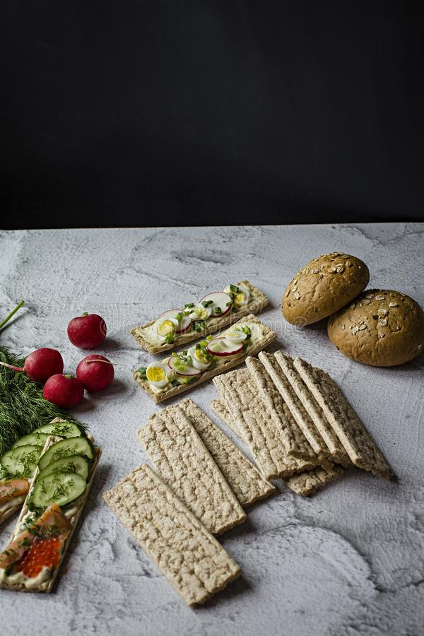 Dietary bread. Substitute for slimming bread. Vegetarian sandwiches. Proper nutrition. Light background. Close-up.  stock photos