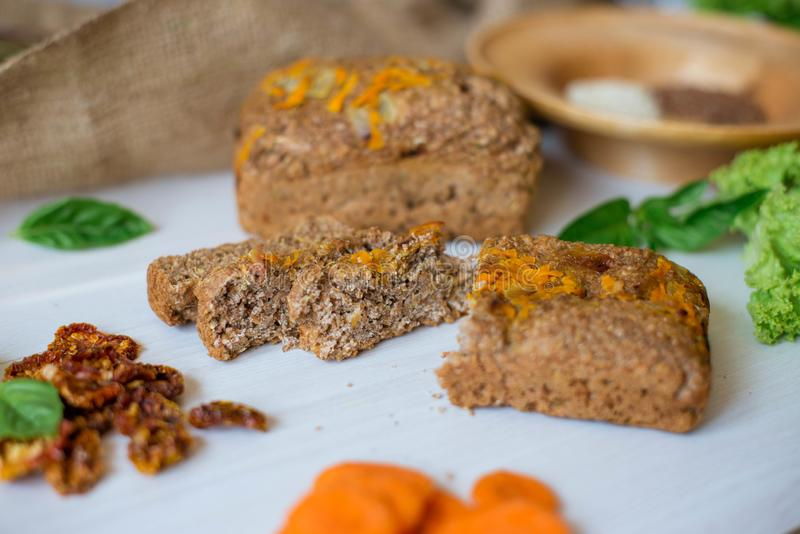 Dietary bread without yeast from whole grain flour. Healthy food, bread with vegetables and bran.  royalty free stock image