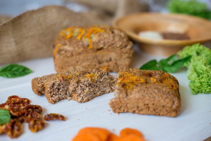 Dietary bread without yeast from whole grain flour. Healthy food, bread with vegetables and bran.  royalty free stock photos