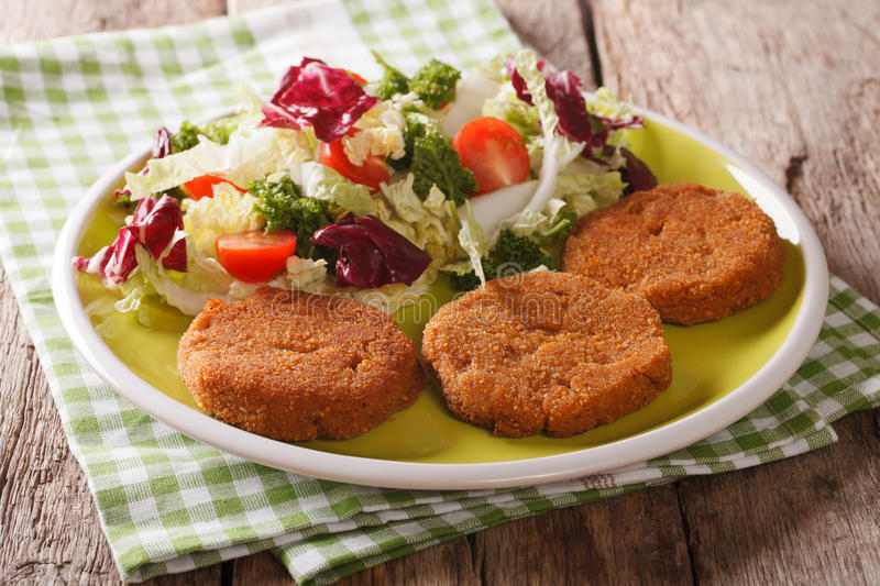 Dietary breakfast: carrot cutlets and salad of chicory, cabbage stock photos
