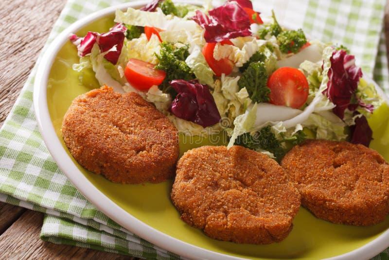 Dietary carrot burgers and fresh salad mix close-up. horizontal royalty free stock photos