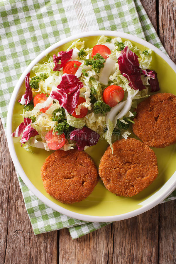 Dietary carrot burgers and fresh salad mix close-up. vertical to stock images