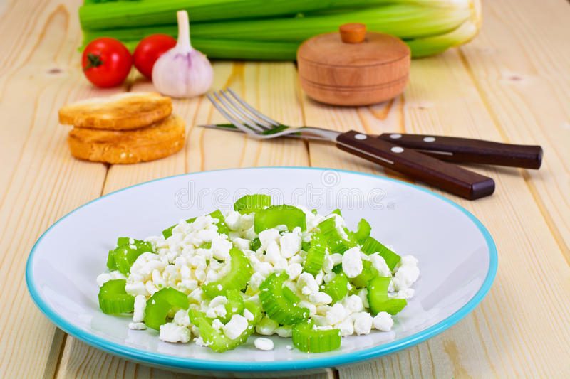 Dietary Dish of Granulated Cottage Cheese and Celery. Studio Photo royalty free stock images