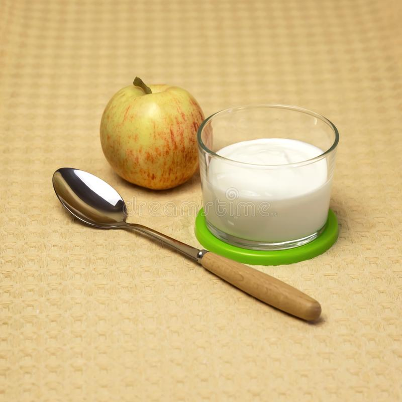 Dietary food. Milk product. Fruit yogurt in a glass with a fresh royalty free stock photography