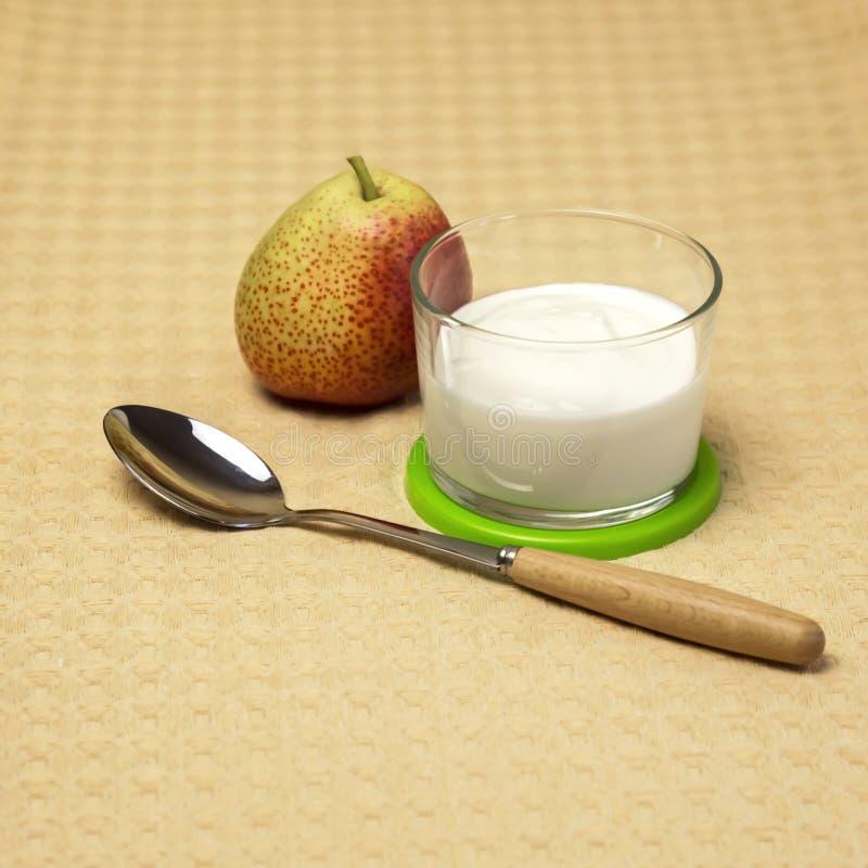 Dietary food. Milk product. Fruit yogurt with fresh red pear. stock photos