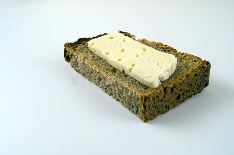 Dietary food. Skimmed cheese on black bread.  royalty free stock photo