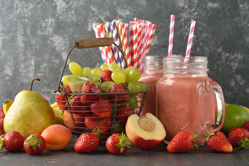 Dietary fruit smoothies. On a gray background stock images